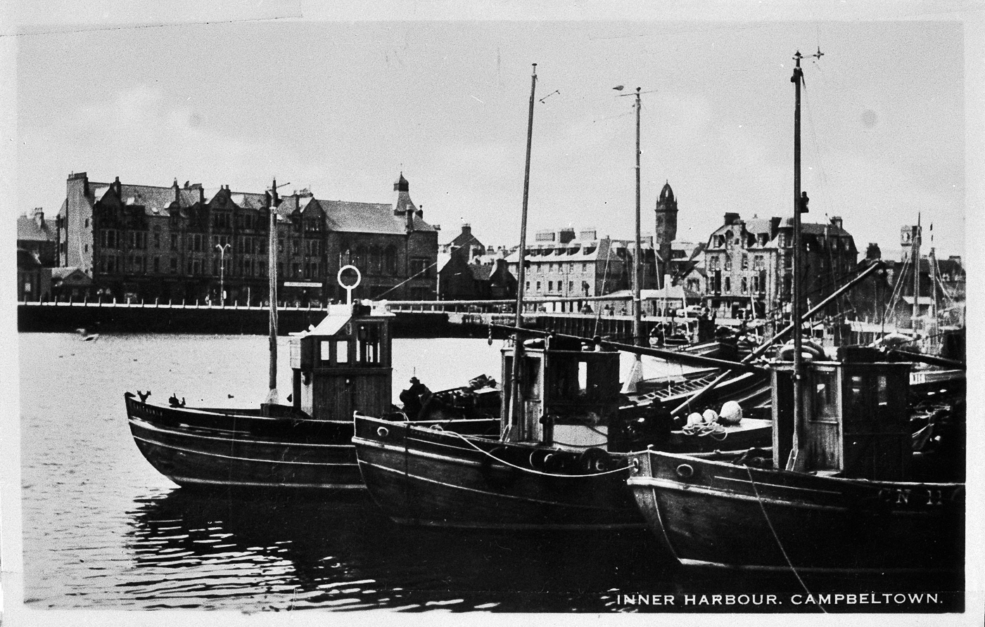 Postcard entitled 'Inner Harbour, Campbeltown' showing ringnetters 'Acadia', CN56, 'Harvest Queen', CN167, and 'Regina Maris', CN118. 'Acacia', CN56, was built in Portavogie, 1949. 'Harvest Queen', CN167, was built in Fairlie in 1949 then later sold to Skye in 1983.