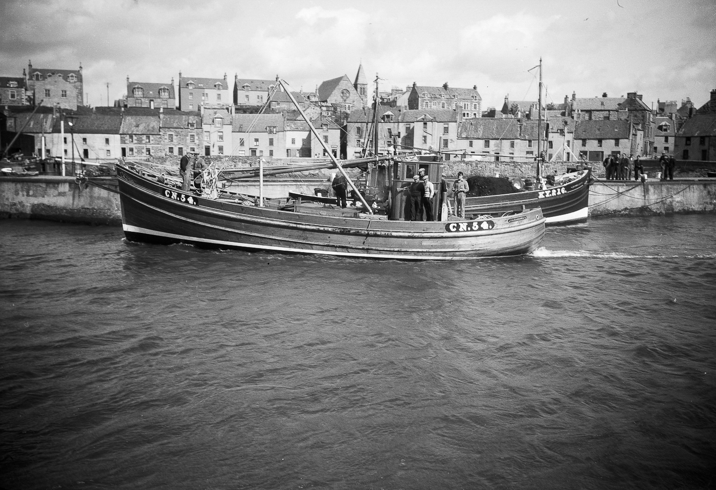 'Almanzora' CN54, in harbour, St Monans, 1949. 'Almanzora', CN54, was built by J. N. Miller boatbuilders, St Monans, for the Robertson brothers who lived on the west coast. She was 53ft long and weighed 23 tons. She later became 'Mairead', TT104, then 'Sancta Virgo', CY254. She stopped fishing in 1979 then was later sold abroad.